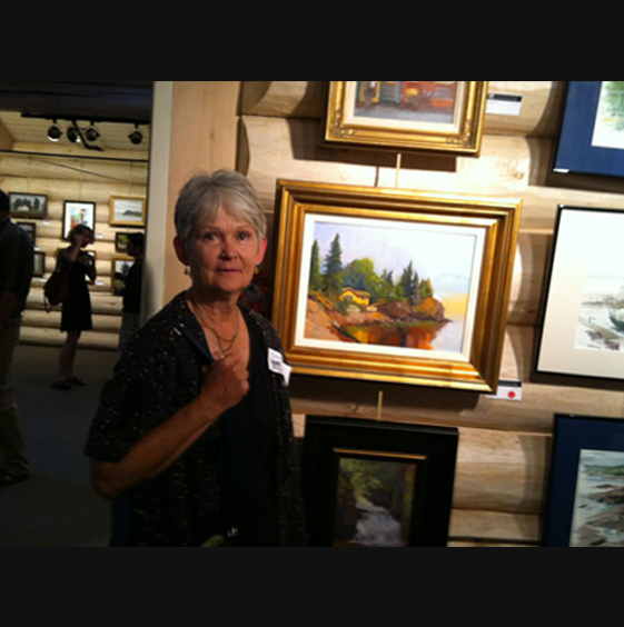 Susan Novak and her painting of cabin 6